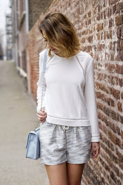 white sweater with liquid silver shorts in silver