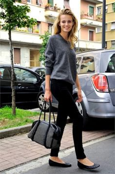 gray sweater with crew neck with black skinny pants and leather ballet flats