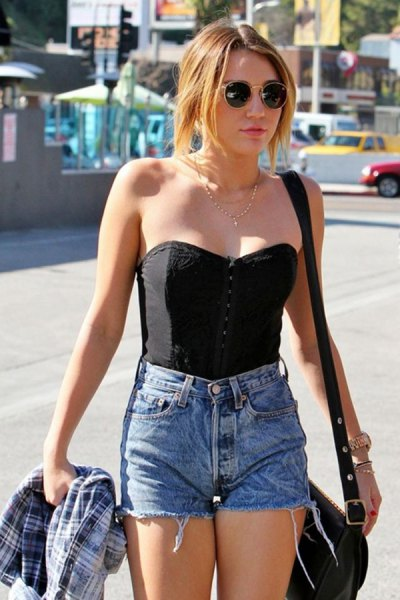 black strapless sweetheart top with high waist blue mini-denim shorts