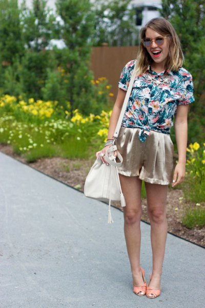 blue and white floral printed shirt with pink gold mini silk shorts