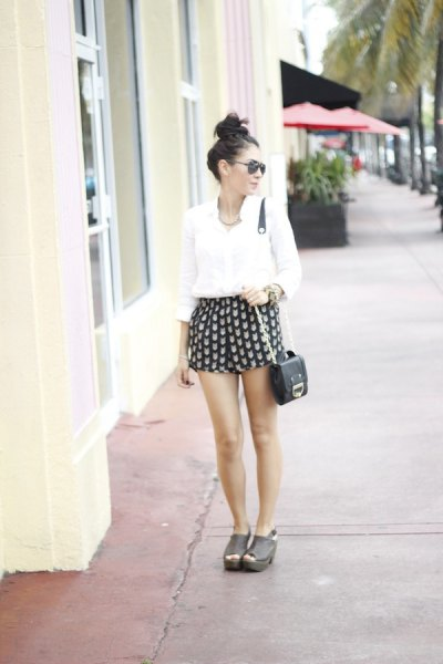 black and pink patterned mini shorts with white button shirt