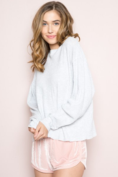 white sweater with blush pink pink silk shorts