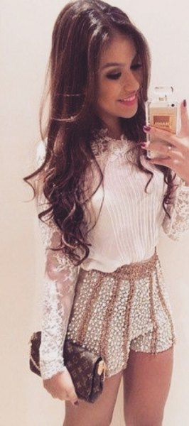 white lace long-sleeved blouse with pink sequins mini shorts