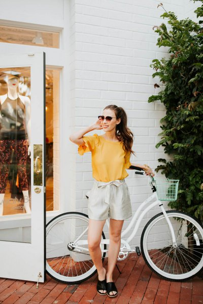 yellow bell-sleeved chiffon top with ivory ribbon dress shorts