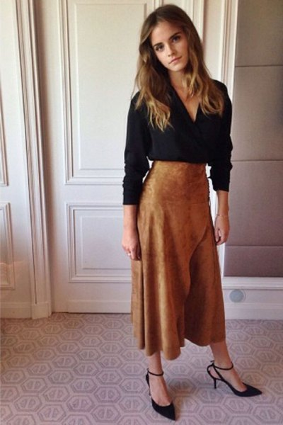 black v-neck long-sleeved blouse with brown suede maxi extended skirt