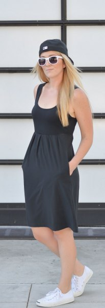 black knee length sundress with baseball cap