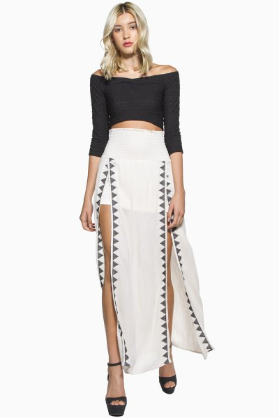 white maxi skirt with black three quarters sleeve outside the shoulders