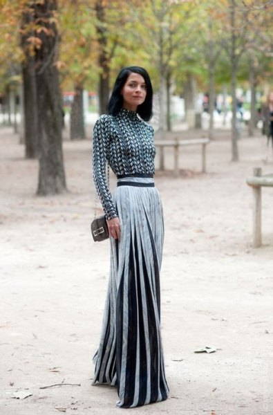 black and white patterned hair cover with silver pleated maxi skirt