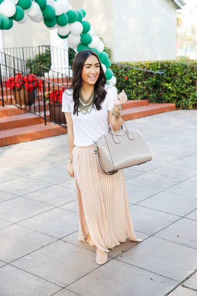 white t-shirt with pink pleated maxi skirt