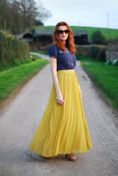 navy blue short sleeve blouse with lemon yellow maxi pleated skirt