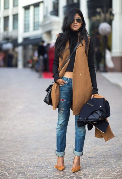 green sleeveless trench coat with black sweater hair
