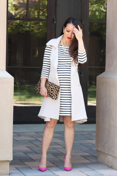 sleeveless gown with black and white striped long sleeve dress