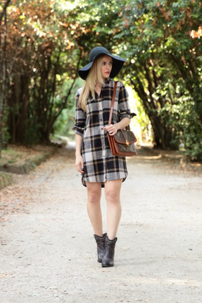 gray and white plaid flannel shirt dress with black floppy hat