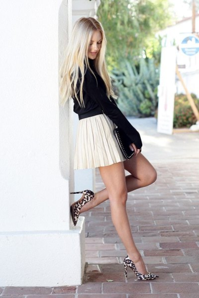 black knit sweater with suede with white pleated miniskirt