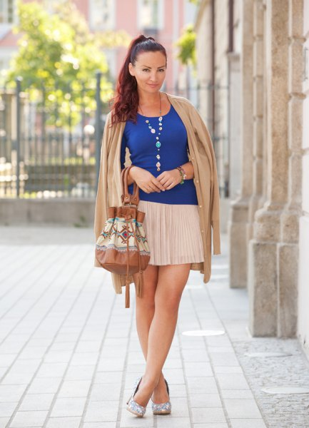 royal blue top with white pleated mini skirt
