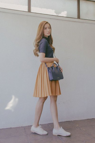 gray short sleeve top with mock neck with orange pleated skater mini skirt