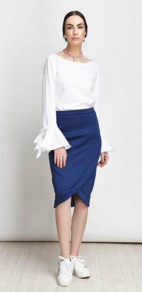 white watch sleeve top with dark blue tulip skirt