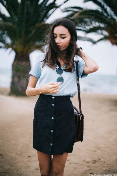gray t-shirt with black high waist button down miniskirt