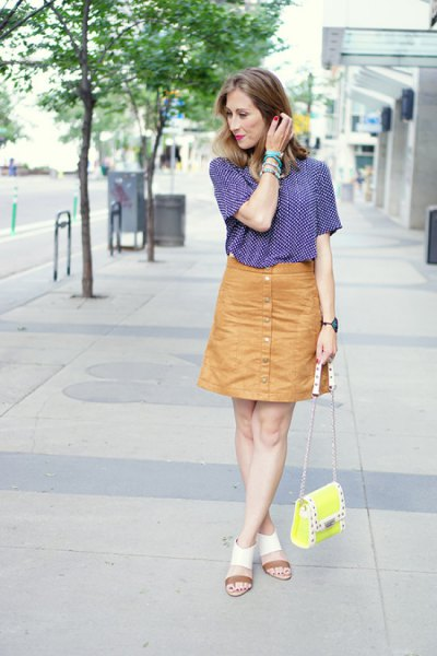 navy and white patterned short-sleeved shirt with orange button down skirt
