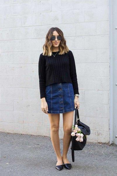 black rib knit sweater with dark blue button in denim mini skirt