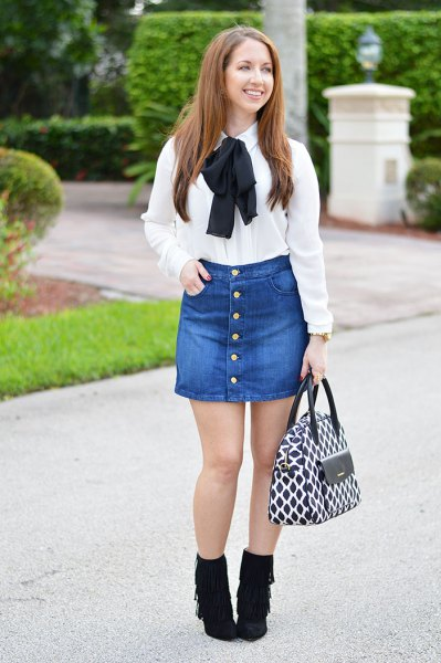 white ribbon bow shirt with denim skirt on the front