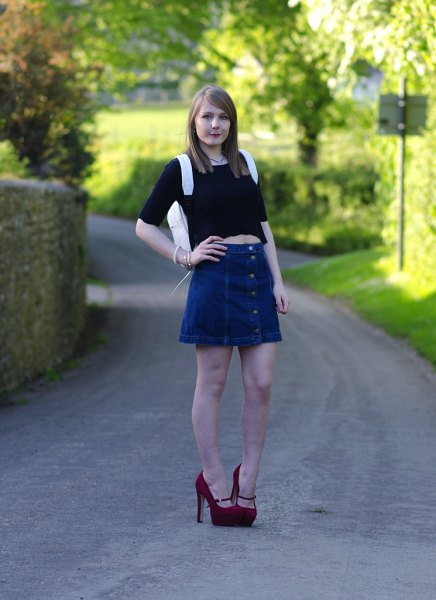 black half-heated crop top with blue mini-blown denim skirt