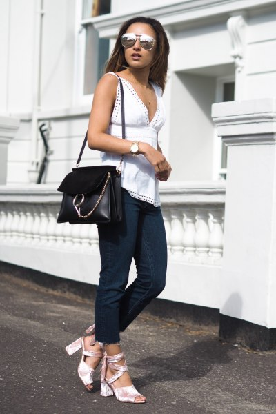 white low-cut sleeveless tops with open toe heels in silver