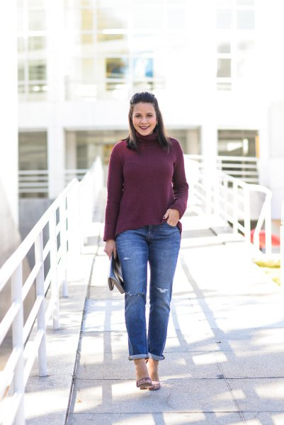 black sweater and cuffed jeans