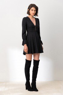 black puff sleeve mini dress with high thigh boots