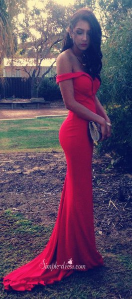 red strapless floor length flowing dress