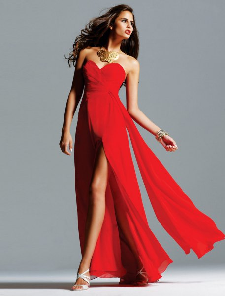 red high split floor length dress with statement necklace