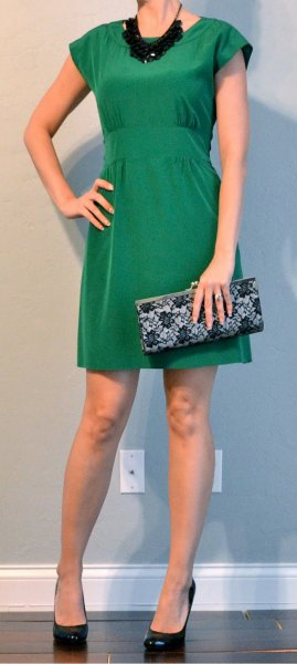 green cap sleeve mini cocktail dress with black statement necklace