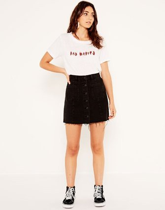 white print tee with black button front denim skirt