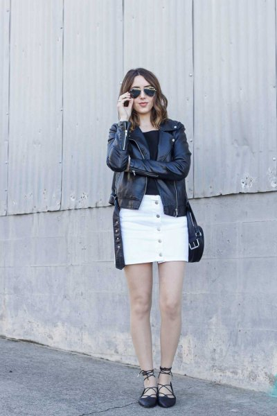 black leather jacket with white denim skirt