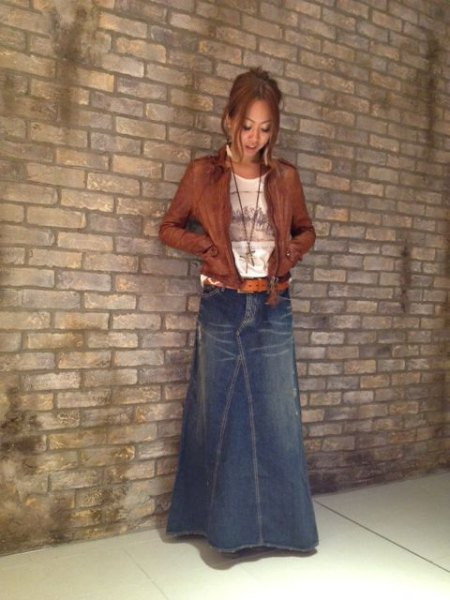 blue light flushed maxi denim skirt with brown leather jacket