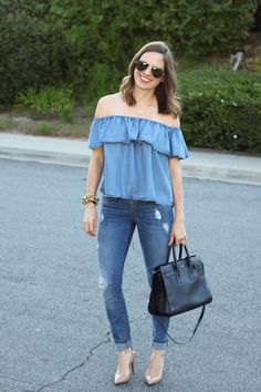denim of shoulder blouse with blue cuffed skinny jeans