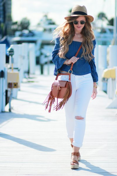 white ripped skinny jeans and straw hat