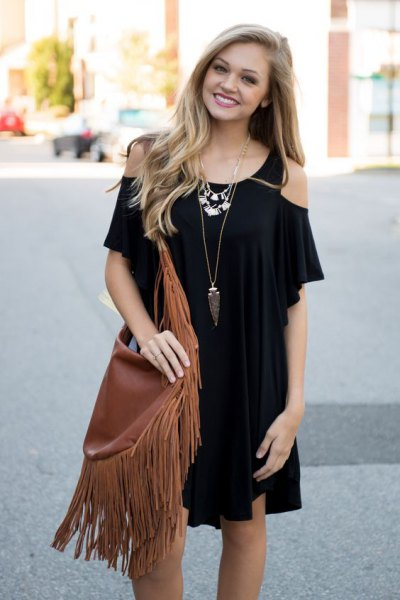black cold shoulder mini dress with brown fringe bag