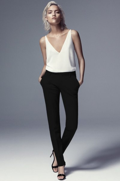 white deep v-neck stockings with black skinny dress pants