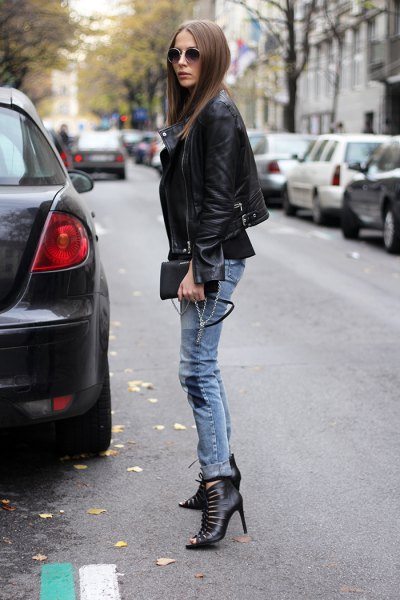 black blazer with gray-blue skinny jeans cutout boots