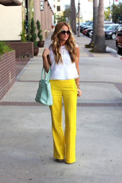 yellow inflatable sailor pants with white sleeveless lace top