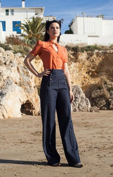 orange keychain blouse with dark blue broad-legged trousers