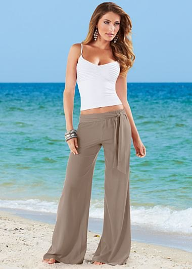 green flared cotton trousers with white cropped vest