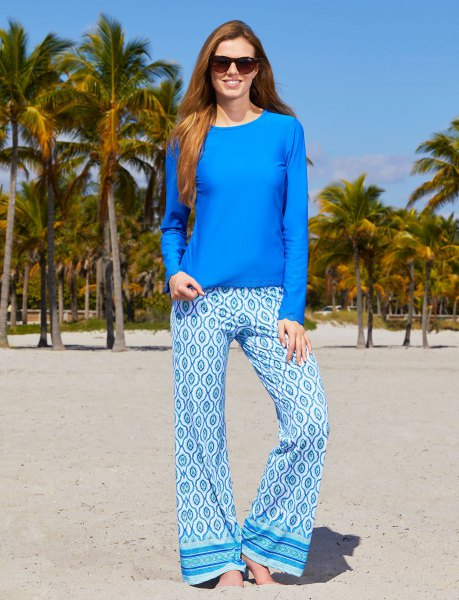 royal blue long-sleeved top with tribal printed leggings with wide legs
