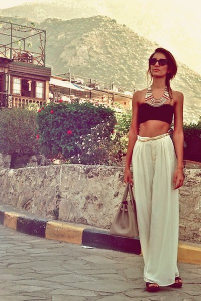 black cropped tube top with white wide leg trousers