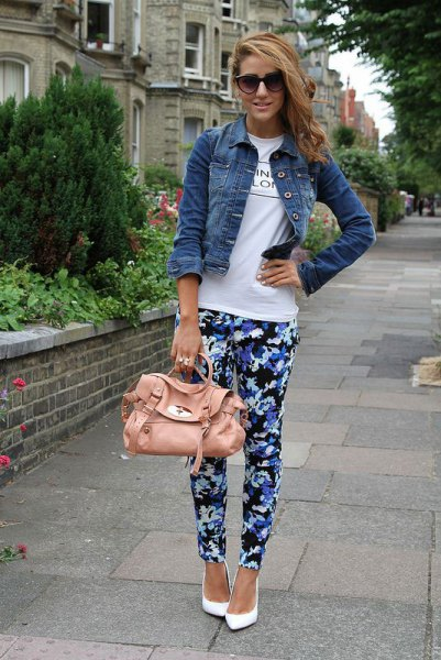 blue and black floral pants with white print tee and denim jacket