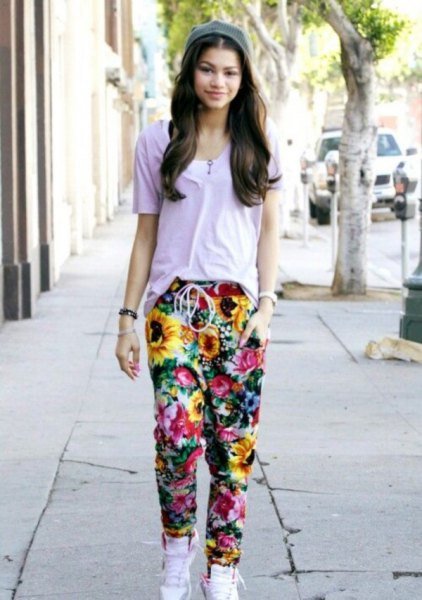 gray t-shirt with floral baggy pants and white high top sneakers