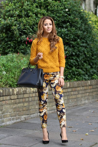 green knitted sweater with black floral pants
