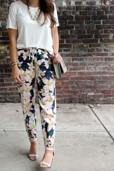 white t-shirt with navy blue floral pants