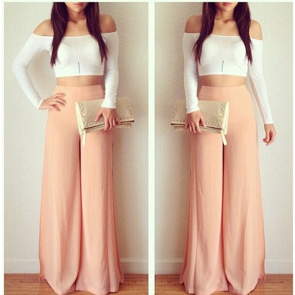 pink trousers with white off the shoulder cropped shape fitting top